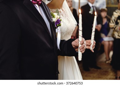 wedding ceremony of stylish elegant brunette bride and groom win the old church
