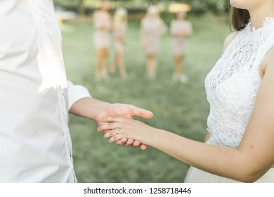 Wedding ceremony vows, bride and groom holding hands