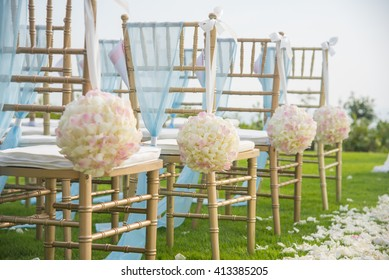 Wedding chair decorated with flowers.