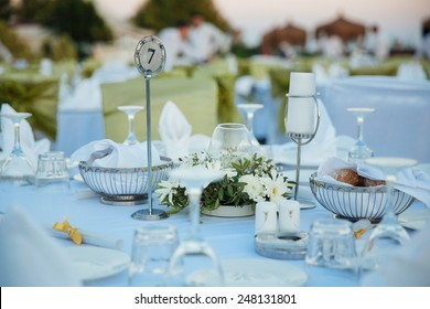 Wedding Chairs and covers at an outdoor wedding