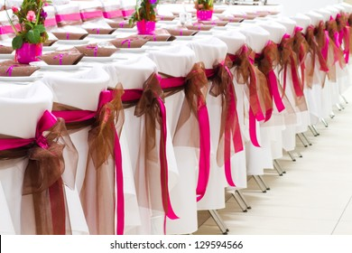 wedding chairs with silk ribbons
