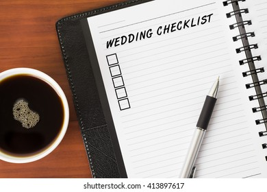 Wedding Checklist word on a notebook with a pen and a cup of coffee