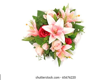 Wedding composition bouquet of roses and lily in pink and red colors isolated on white background
