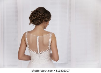 Wedding concept - beautiful bride just before wedding ceremony, back view.