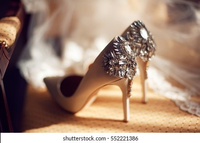 wedding concept. bride's shoes and veil