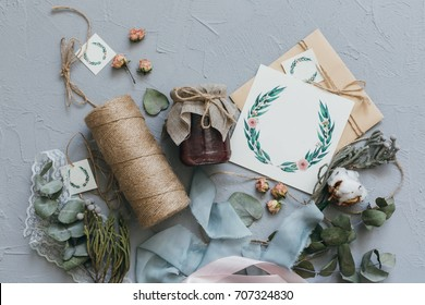 A wedding concept. Invitation and items on a grey stone background.