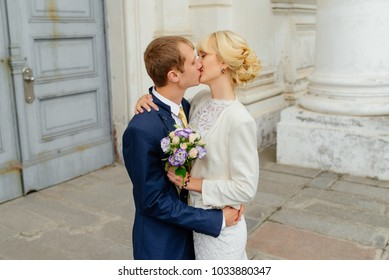 Wedding couple. Beautiful couple, bride and groom against a white castle. Wedding couple in love at wedding day. Bride dress, groom suite, happy wedding day.