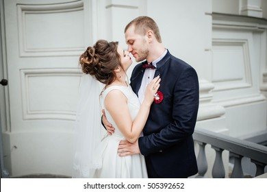 Wedding couple. Beautiful couple, bride and groom look at each other against a white castle