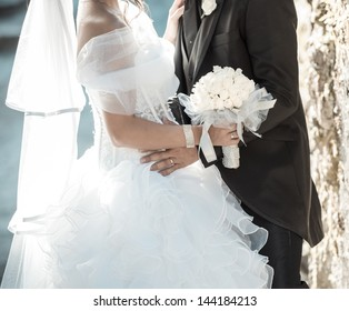 Wedding couple with a bouquet