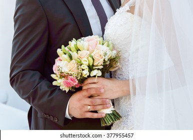 Wedding couple with the bouquet