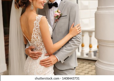Wedding couple. Bride and groom embracing at wedding day