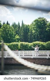 Wedding Couple Bride and Groom on a Wedding Walk near the Park Pond