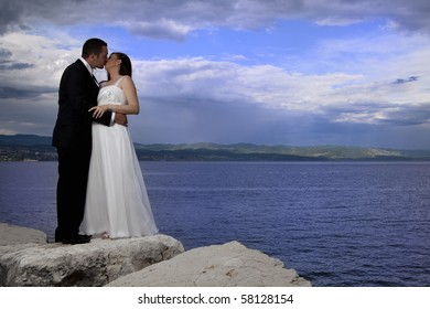 Wedding couple by the sea
