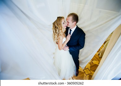 Wedding couple in the curtains