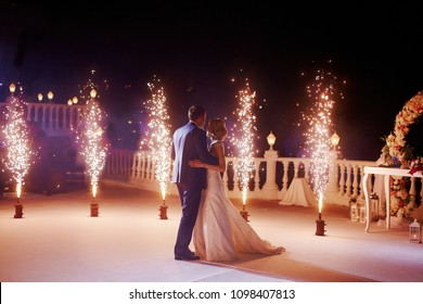 Wedding couple dancing in sparklers their first dance