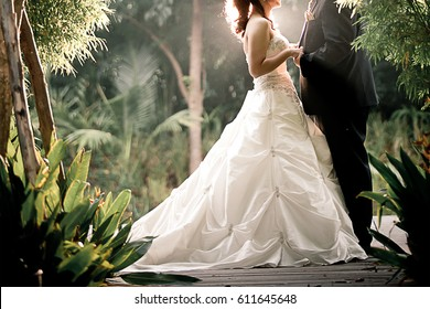 wedding couple enjoying romantic moments outsides on a summer. Happy bride and groom on their wedding. Beautiful young wedding couple outsides in nature. Photo for vanlentine background