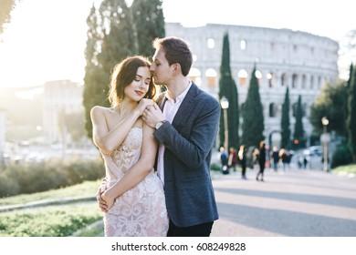 Wedding couple fineart walk outside Rome colosseum