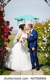Wedding couple in the flowers at summer time