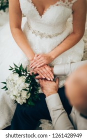 wedding couple hands and wedding bouquet