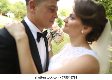 wedding couple holding bouquet of flowers