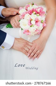 Wedding couple holding hands with a bouquet of flowers with text