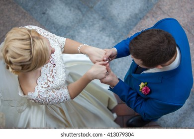 Wedding couple holding hands during the ceremony.