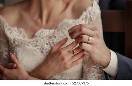 wedding couple holding hands, happy groom and bride