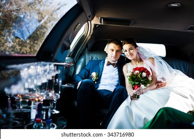 wedding couple indoor the limousine