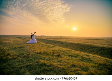 Wedding couple in love. Bride and groom embracing after wedding ceremony. Marriage concept