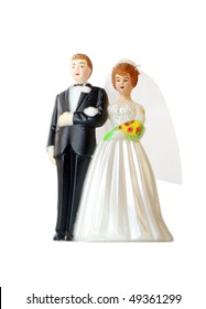 A wedding couple made of plastic, models for wedding cake, isolated on white background