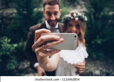 Wedding couple making selfie