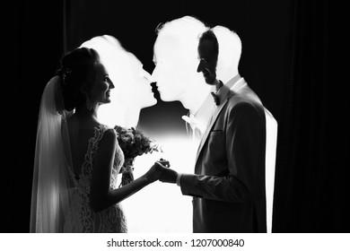 Wedding couple. Multi exposure effect, silhouete of bride and groom. Creative black and white art wedding photo