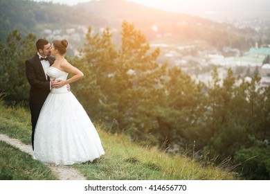 Wedding couple in nature against the backdrop of the city away