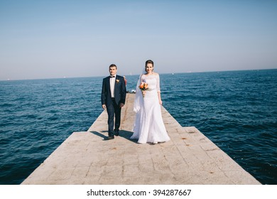 Wedding couple on the background of the sea
