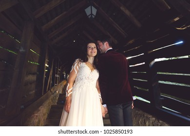 Wedding couple on the old wooden house