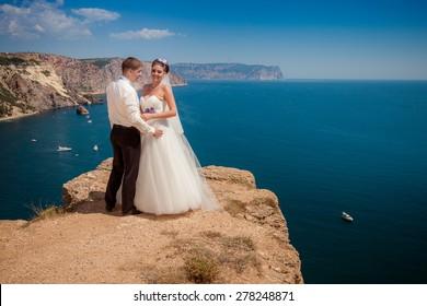 Wedding couple on sea background