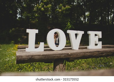 Wedding couple outdoors with word love