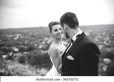 Wedding couple posing for the camera on the hump