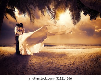 wedding couple with the sunset on the tropical beach