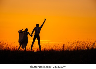 wedding couple with the sunset. romantic concept