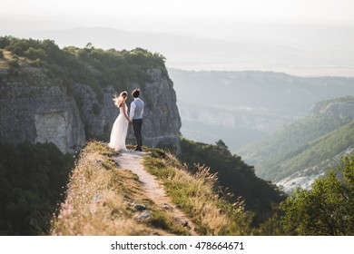 Wedding couple walking in the mountains with stunning views