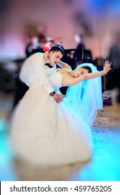 Wedding dance of young couple in restaurant