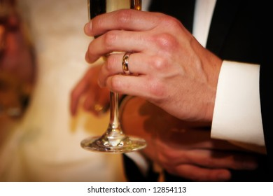 Wedding day bride and groom arm in arm while toasts are happening