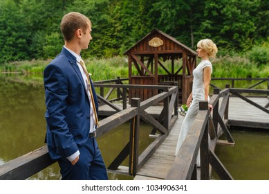 Wedding day. bride and groom outdoor in nature location. Wedding couple in love at wedding day. Bride dress, groom suite, happy wedding day.