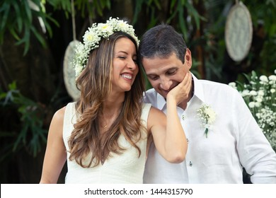 Wedding day bride and Groom showing their love in an outdoor wedding. In love concept. Newly weds happy couple celebrating love. Happily ever after. Latin American people marriage ceremony.