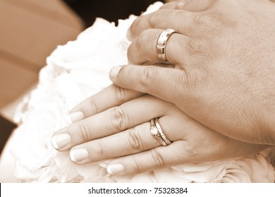 Wedding Day Bride and Grooms hands With Rings