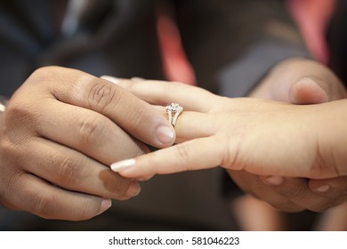 wedding day. bride put the ring on groom