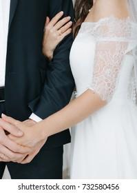 Wedding day. Concept. The bride hugs her fiancé.