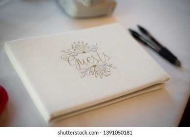 Wedding day guestbook for guests to sign on the couples wedding day celebration of love and marriage