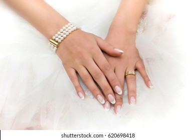 Wedding day. Luxury bracelet of pearls on the bride's hand